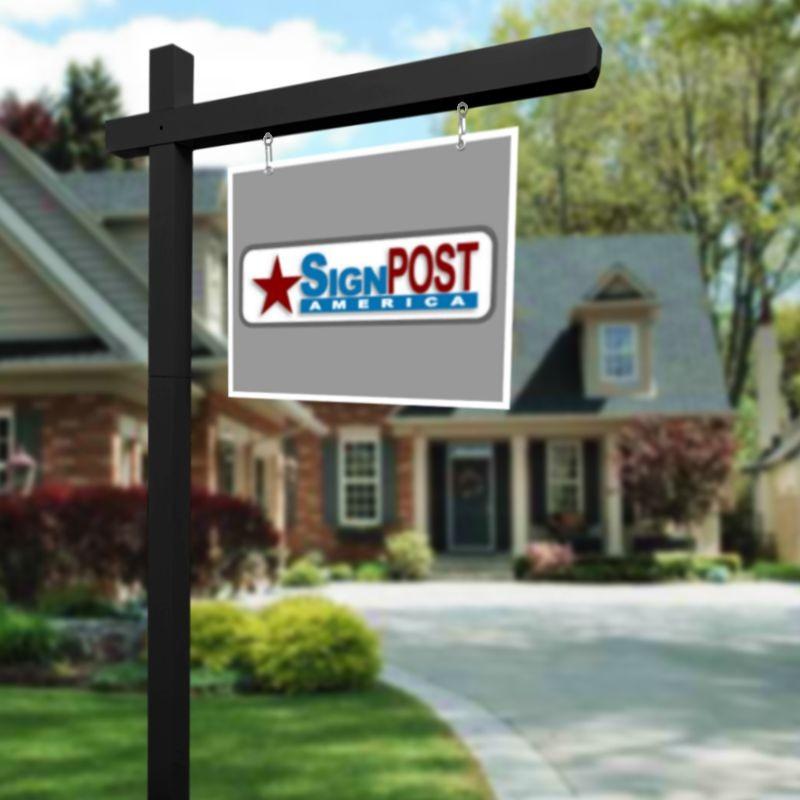 black real estate sign post